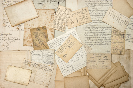 Old letters, handwritings, vintage postcards, ephemera. Grungy paper texture