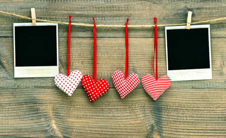 frienship: Red hearts and vintage photo frames. Valentines Day decoration Stock Photo