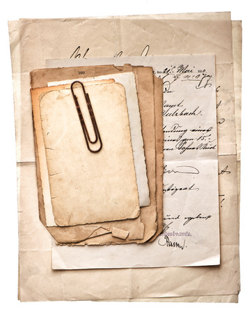 pile of old vintage papers, postcards and letters with paper clip on white background photo