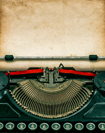 Vintage typewriter with aged textured grungy paper Archivio Fotografico