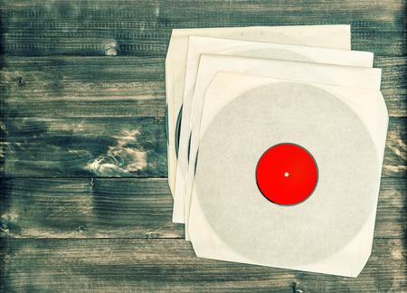nostalgic: vintage vinyl records on rustic wooden background. nostalgic retro objects