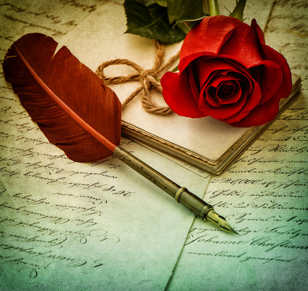 sentimental: Old letters, rose flower and antique feather pen. Romantic sentimental background. Vintage style toned picture. Selective focus