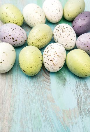 nostalgic: Colored easter eggs on wooden background. Nostalgic retro style decoration