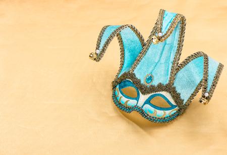 harlequin: Blue carnival mask harlequin. Holidays background. Symbol of venetian mask festival Stock Photo