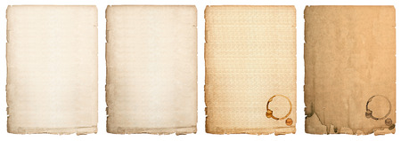 aged paper sheet isolated on white background. used book page with coffee stains