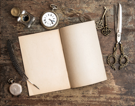 open diary: Open diary book and antique writing tools on wooden background Stock Photo