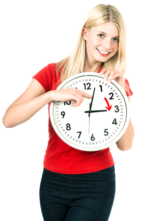Young woman holding a clock. Time management concept. Summer time Daylight Saving Time