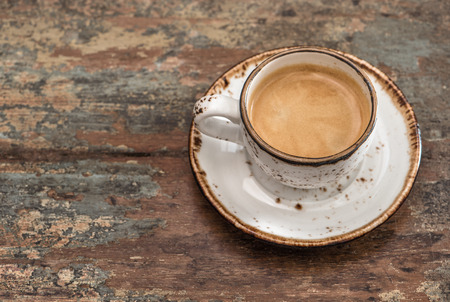 wooden table top view: Cup of black coffee on wooden table. Top view Stock Photo