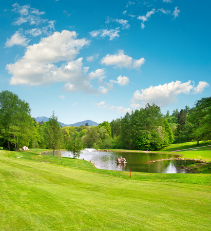 of course: Golf field. European landscape with green grass and beautiful blue sky