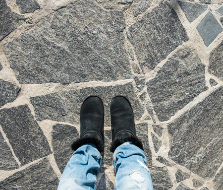 selfy: Selfie of foot and legs with black shoes and blue jeans from above Stock Photo