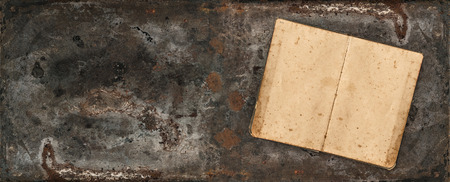 Open antique recipe book on rustic textured background. Vintage style toned banner with space for jour text