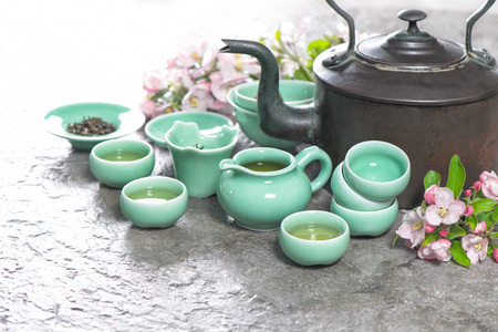 Stil: Traditional chinese tea ceremony. Teapot and cups on stone table. Asia style stil life