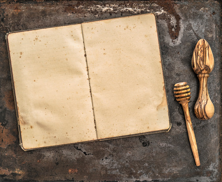 recipe book: Antique recipe book and wooden kitchen utensils. Retro style toned picture Stock Photo