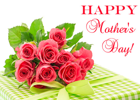 greeting cards: Bouquet of fresh pink roses with gift isolated on white background. Floral arrangement with sample text Happy Mothers Day!