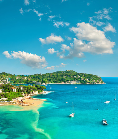nice france: Turquoise Mediterranean sea and sloudy blue sky. Villefranche by Nice, French riviera. Summer holidays