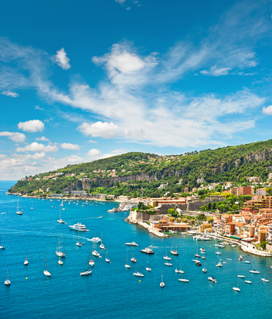 sea resort: Summer holidays background with beautiful blue sky. French riviera, Mediterranean Sea. View of luxury resort and costline of Villefranche by Nice France