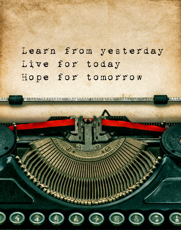 Vintage typewriter with aged textured grungy paper. Sample text Learn from yesterday, live for today, hope for tomorrow