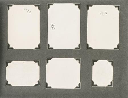 photo album page: Old photo album page with corner over dark background.