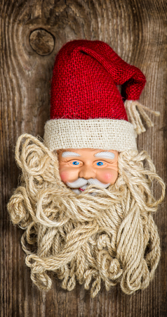 nostalgic christmas: Vintage Santa Claus toy. Nostalgic Christmas background. Retro style toned picture