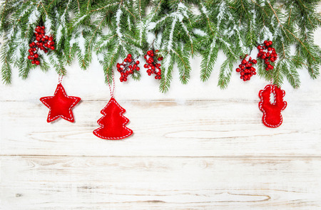 hollyberry: Christmas tree with red decoration. Winter holidays background
