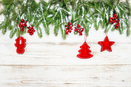hollyberry: Christmas background. Evergreen tree branch with red berries and decoration