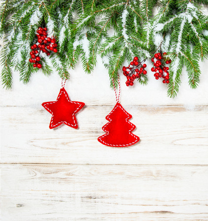 hollyberry: Christmas tree branches with red decoration. Winter holidays background