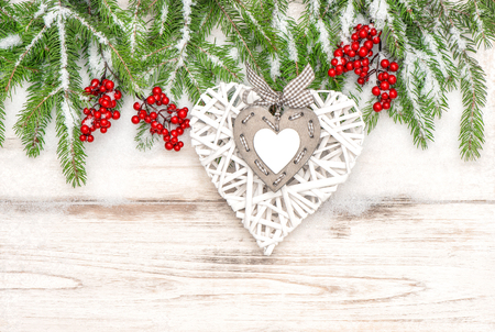 hollyberry: Christmas decoration on bright wooden background.