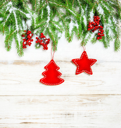 hollyberry: Christmas decoration. Winter holidays background with red ornaments and snow Stock Photo