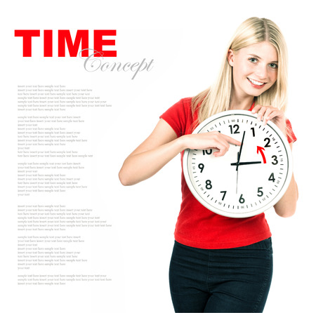 blonde teenage girl: Young woman holding a clock. Time management concept. Winter time Daylight Saving Time