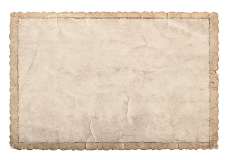 Old paper frame with carved edges for photos and pictures. Used cardboard texture isolated on white background