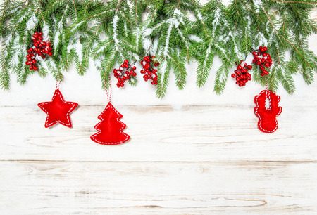 hollyberry: Christmas tree border with red decorations. Winter holidays background Stock Photo