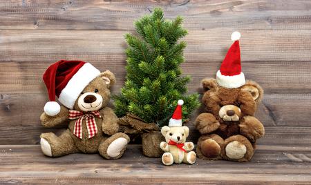 animal photo: Christmas decoration with nostalgic toys Teddy Bear family. Vintage style toned picture