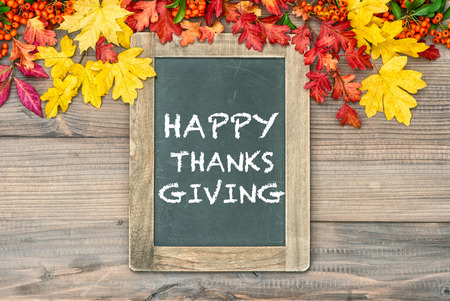 happy thanksgiving: Autumn Background with colorful leaves and blackboard. Sample text Happy Thanksgiving