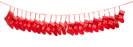 christmas concept: Advent calendar 1-24. Red christmas stocking isolated on white background. Holidays decoration