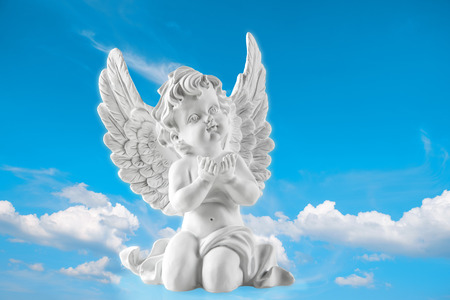 guardian: Guardian engel on blue sky background. Religion and faith concept