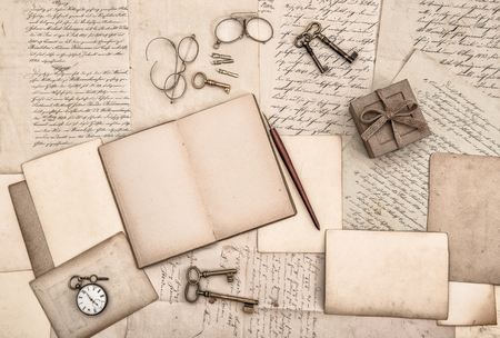 nostalgic: Old handwritten letters and antique writing accessories. Nostalgic paper background