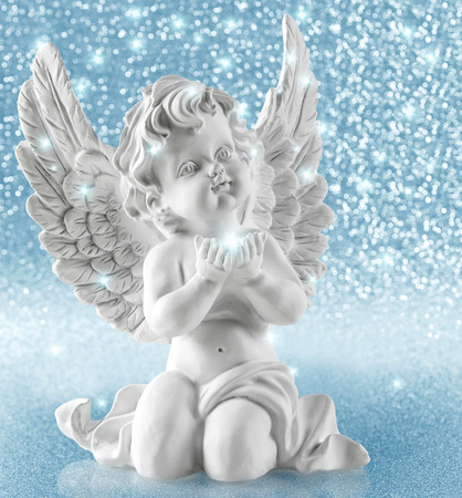 Guardian angel on shiny background. Christmas decoration. Collage with lights and stars effect 스톡 콘텐츠