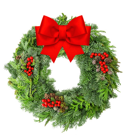 Christmas wreath from spruce, pine and fir twigs with red ribbon bow isolated on white background Stockfoto