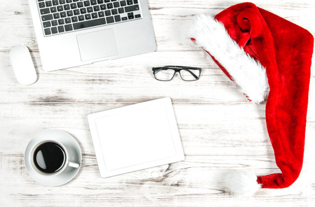 Business Holidays Concept. Office Workplace with Cup of Coffee and Christmas Decoration. Space for Your text