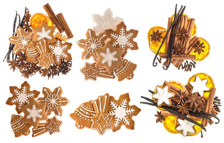 white backing: Gingerbread cookies and spices isolated on white background. Christmas sweet food ingredients. Cinnamon sticks, star anise, vanilla and cloves