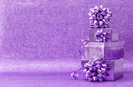 blue bow: Gifts with ribbon bow on bright background. Violet holidays decoration Stock Photo