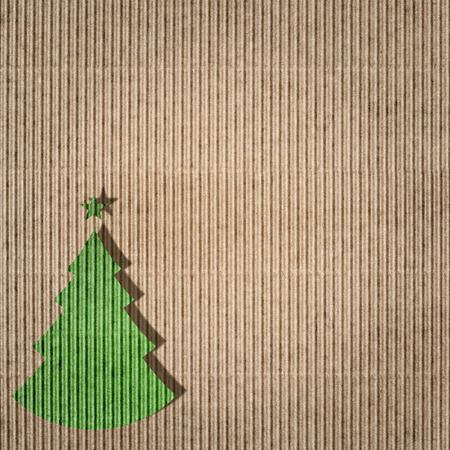 green environment: Green christmas tree on recycling paper. Environment friendly card concept