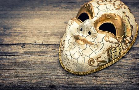 harlequin: Carnival mask harlequin. Mardi gras. Holidays background. Vintage toned