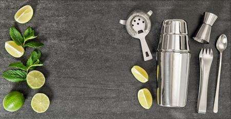 Drink making tools and ingredients for cocktail lime and mint. Top view Standard-Bild