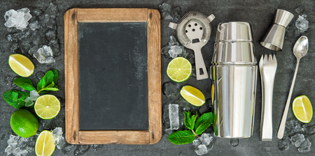 Drink making tools and ingredients for cocktail. Lime and mint leaves. Chalkboard for Your recipe text