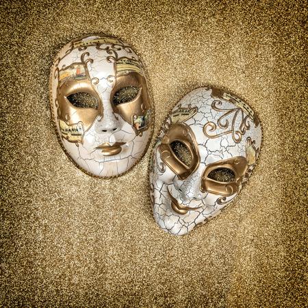 harlequin: Carnival mask harlequin. Mardi gras. Holidays background. Vintage style toned picture