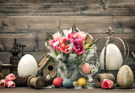 pink flower: Easter decoration with pink tulips and colored eggs. Vintage style toned picture Stock Photo