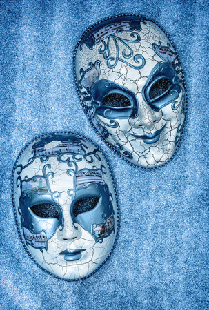 arlecchino: Carnival mask harlequin. Mardi gras. Holidays background. Blue toned Archivio Fotografico