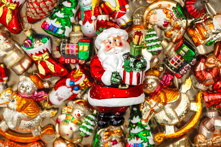 stockings: Santa Claus with christmas tree decorations baubles, toys and colorful ornaments. Selective focus