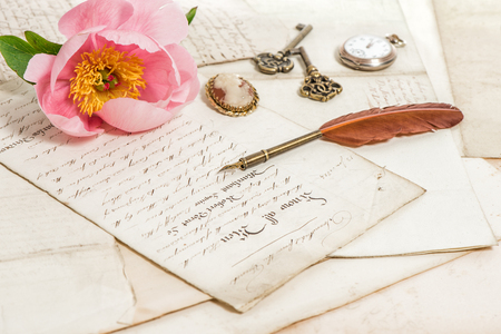 feather pen: Old letters, pink rose peony flower and antique feather pen. romantic vintage background. selective focus Stock Photo